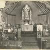 In this early photo the walls are light colored with crosses on them and notice the words above the Altar.